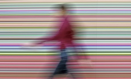 Real style … a woman walks in front of Gerhard Richter's painting 'Strip' showing at the Albertinum gallery in Dresden. Photograph: Jens Meyer/AP